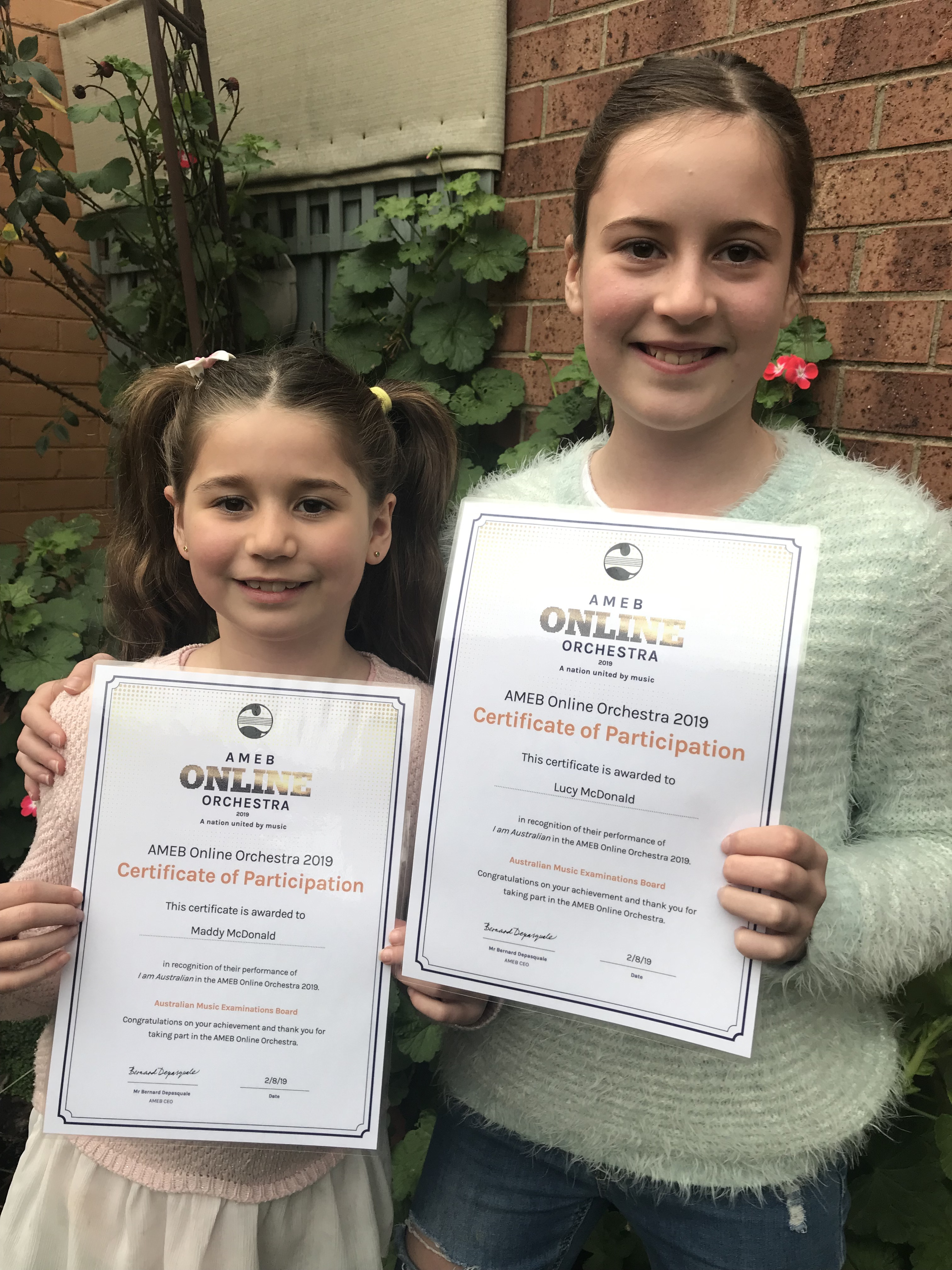 Maddy and Lucy with participation certificates